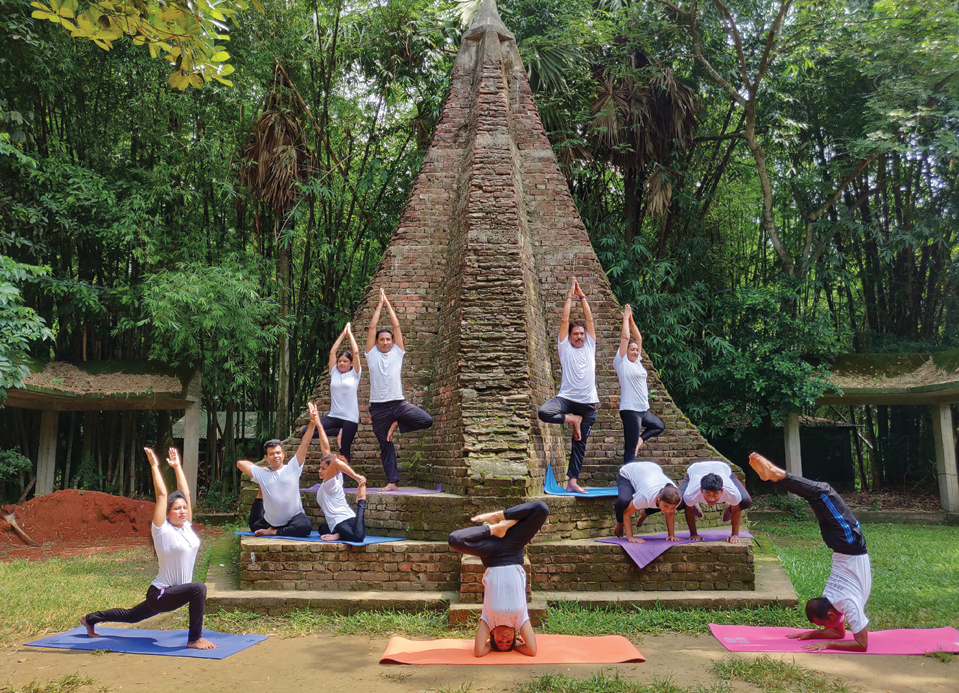 Participants practising different asanas in Dhaka, Bangladesh