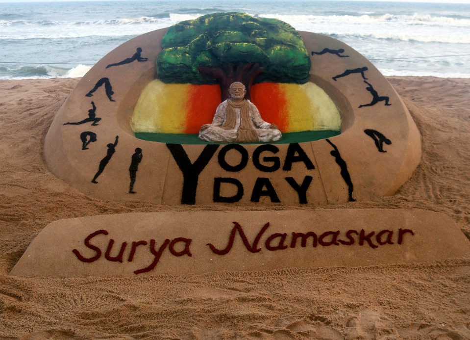 A sand sculpture is seen at the Bay of Bengal Sea's eastern coast beach, creating by sand artist Sudarshan Pattnaik on the International Yoga Day at Puri, 65 km away from the eastern Indian state Odisha's capital city Bhubaneswar.