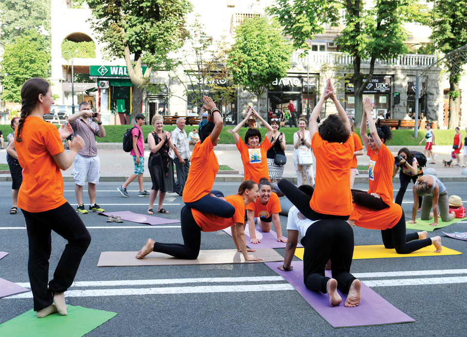 Pedestrians watch as  enthusiasts  celebrate  IDY in Kyiv, Ukraine