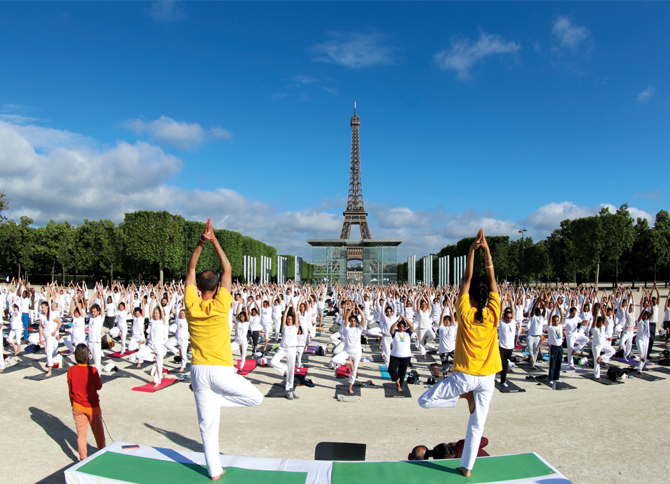 Hundreds performing the iconic  Surya Namaskar near the Eiffel Tower in ParisTop