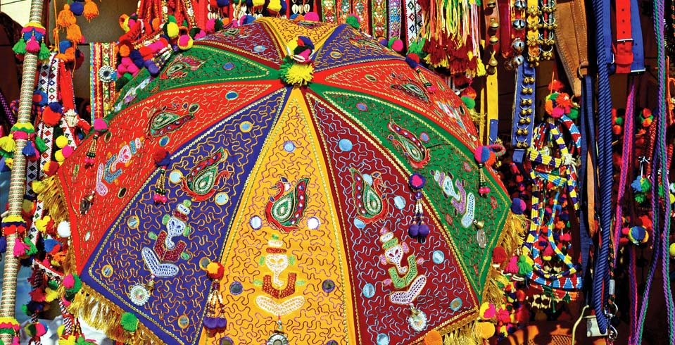 A distinctive feature of the fair is the Tarnetar chhatri (umbrella) meticulously embellished with mirror work, intricate embroidery and lacework