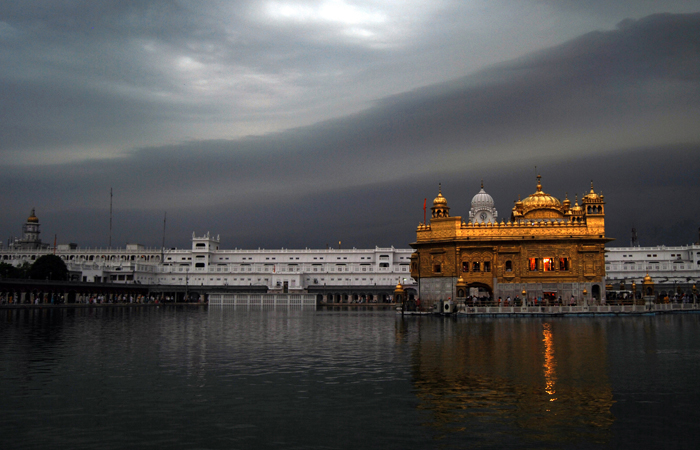 Golden Temple, the holy Sikh shrine in Amritsar, Punjab, stands in stark contrast to the dark monsoon clouds gathering above it. The Indian state of Punjab is home to the mostfertile lands thatdepend on seasonal rains for irrigation