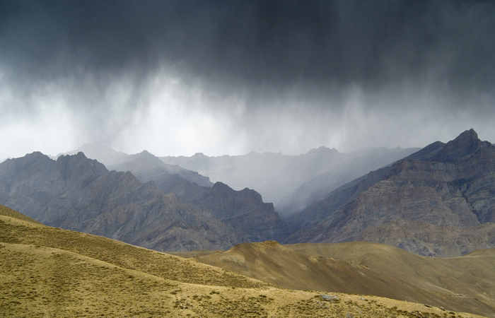 Rain clouds over the mountains surrounding the º in the Zanskar range. The mountain range runs across the high-altitude cold desert in the Union territory of Ladakh