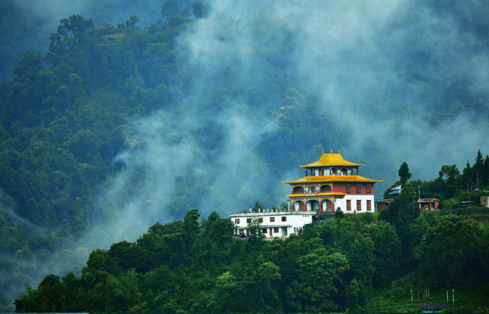 A monastery stands silhouetted against dark rain clouds in Gangtok, the capital of the northeastern state of Sikkim