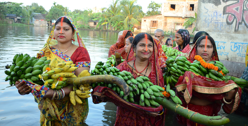 Women offering prayers with bananas during Chhat Puja