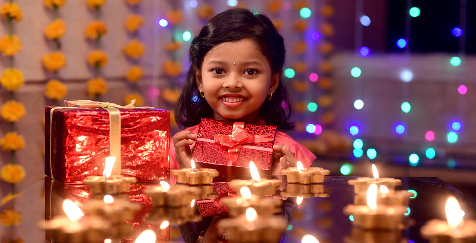 On Diwali, people light diyas (earthen lamps) and exchange gifts, sweets and festive wishes