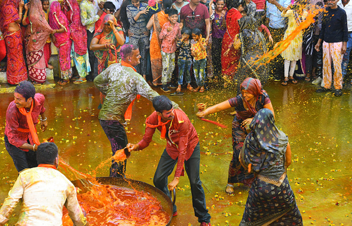 Women playfully hitting men with cloth dipped in coloured water in Beawar, a city in Rajasthan. In this form of the festival played in this region of the state, the mock fight ensues between sisters-in-law and brothers-in-law