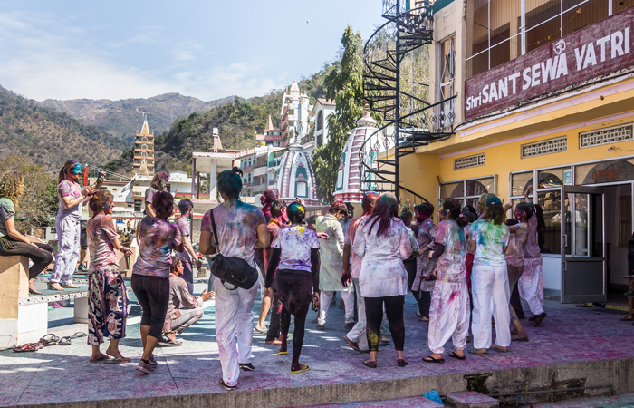 Foreign nationals soak in the spirit of Holi in Rishikesh, Uttarakhand. In the state, Holi is celebrated through various traditions. One of them is called Baithki Holi, in which men sit down and sing songs about the season and the festival