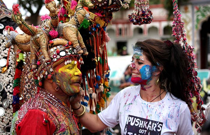 Holi (March 29, 2021) is celebrated with pomp and joy across the country, and even welcomes foreign nationals and tourists to join the festivities. Here, an international traveller applies colours to a man dressed in traditional Rajasthani attire in Pushkar, Rajasthan