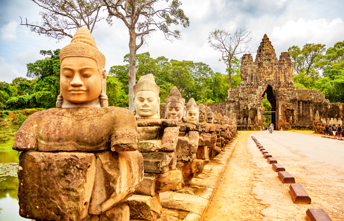 A row of Devas in a depiction of Samudra Manthan (an episode from Hindu mythology) at the South Gate of Angkor Thom complex in Cambodia