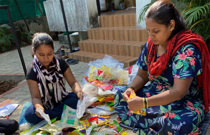 Plastic wrappers collected by Pune-based brand Ecokaari are manually segregated by colour and thickness before being processed