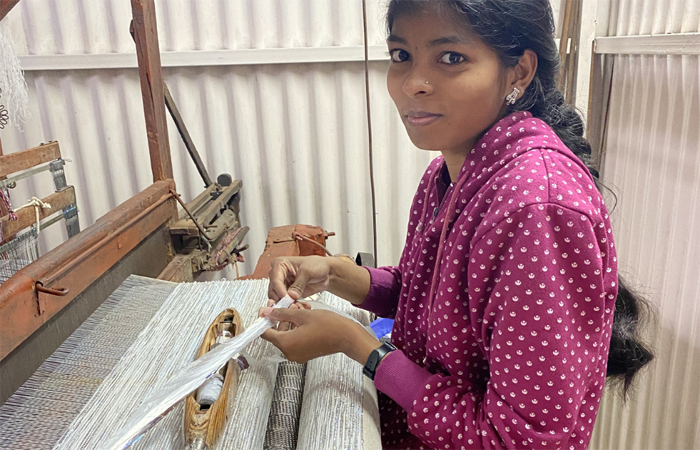 Ecokaari uses traditional handlooms to create sustainable and durable fabrics with upcycled plastic;