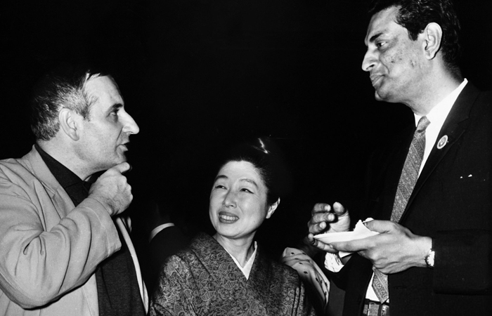 Noted British film director Lindsay Anderson (extreme left), renowned Japanese film producer Madame Kawakita (centre) and Satyajit Ray at a reception hosted by the Indian Documentary Producers' Association at the Third International Film Festival in New Delhi in 1965