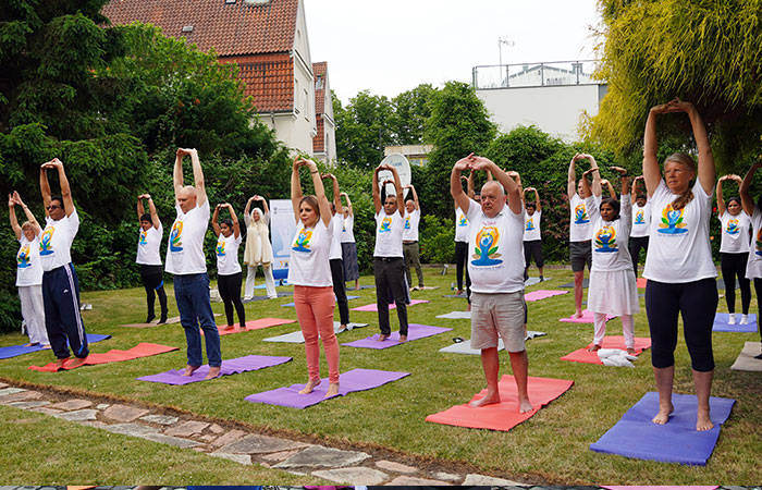 The 7th International Day of Yoga 2021, was celebrated with great enthusiasm in Copenhagen, Denmark, on June 21, 2020, in hybrid mode. The main event was held at the Embassy of India premises with select Danish and Indian dignitaries participating in person and thousands of yoga enthusiasts joining through live streaming. The participants were guided through demonstrations of asanas, pranayama and meditation during the event